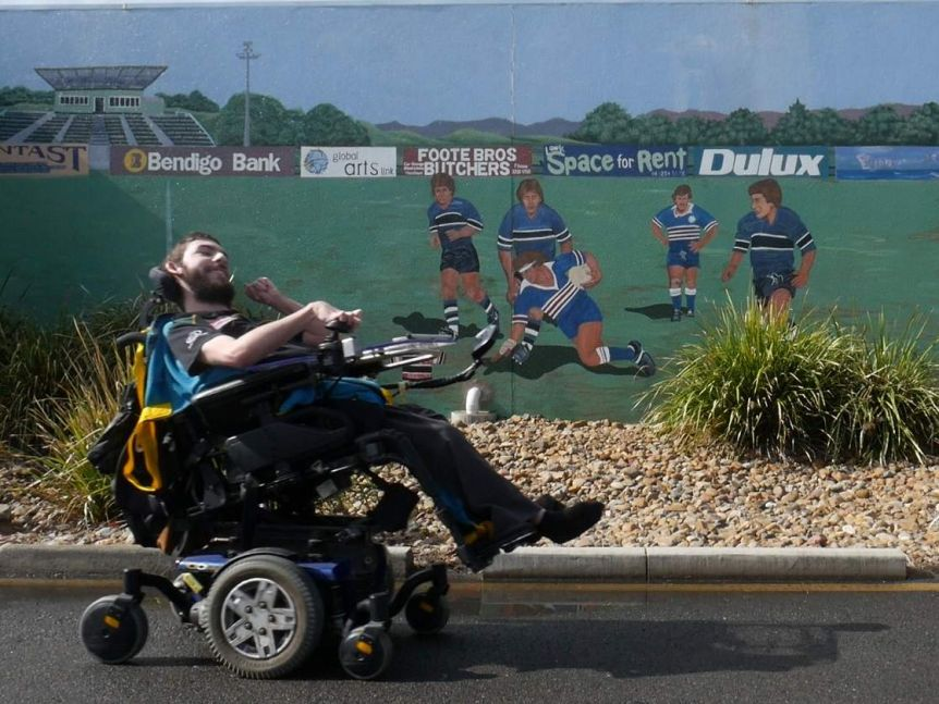 Tyson Turner-Thomas at the Ipswich Jets grounds in north Ipswich, a large mural is painted of the team playing.