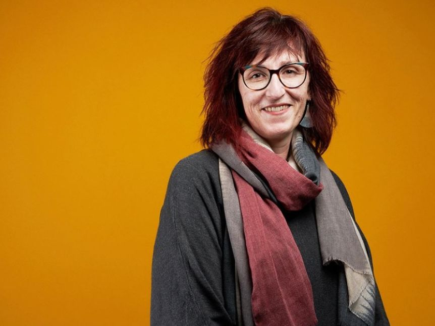 Professor Sally Robinson smiles at the camera for her professional headshot