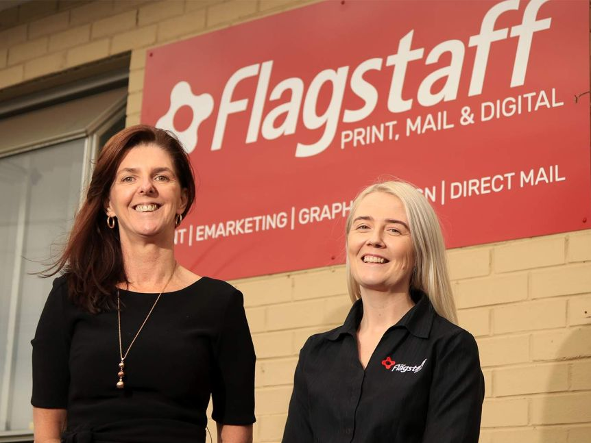 Brooke Anthony and Rachael Walton from Flagstaff stand out the front of their office.