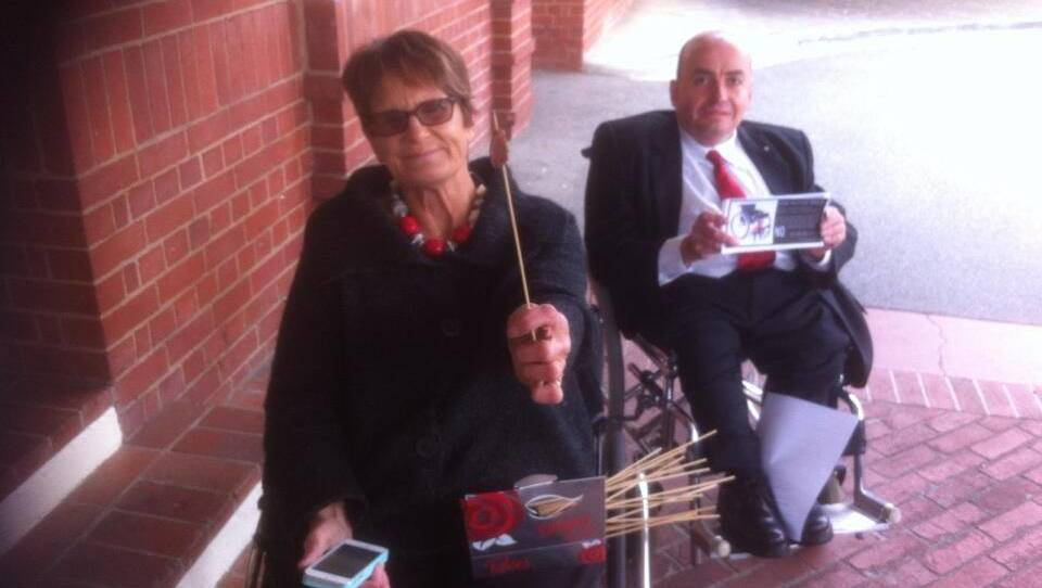 Sue Salthouse and ACTCOSS policy manager Craig Wallace protest outside Canberra's Hyatt Hotel to keep the NDIS. Picture: Supplied.