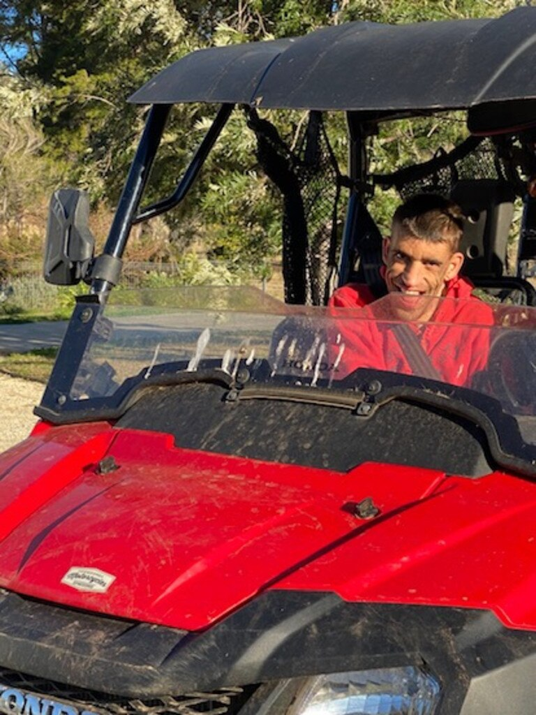 Stephen Davies enjoys a ride in a vehicle on his family's property.